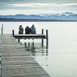 Three at the jetty — Stock Photo