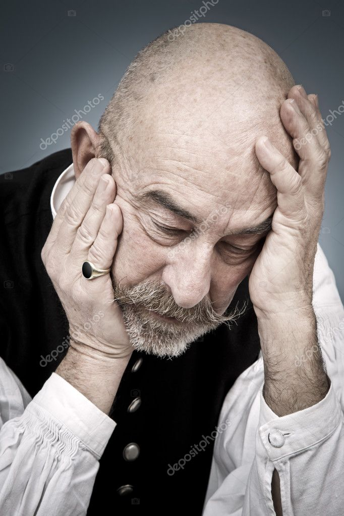 An old man with a grey beard is hopeless  Stock Photo #8597287