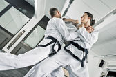Martial arts fighters — Stock Photo