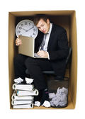 Businessman in a tight office — Stock Photo