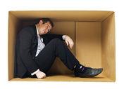 Businessman in a tight cardboard — Stock Photo