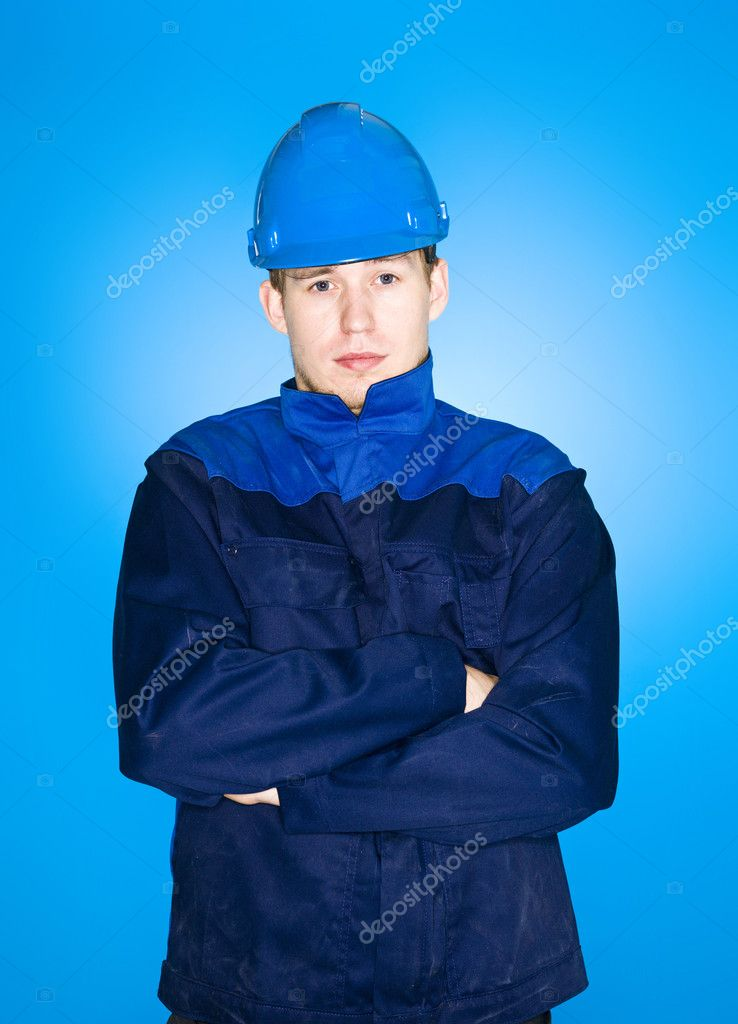 Portrait of a Manual Worker on blue background — Stock Photo #8489081