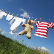Baby clothing on a clothesline - Stok fotoğraf