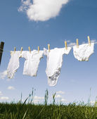Baby clothing on a clothesline — Stock Photo