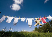 Baby clothing on a clothesline — Stok fotoğraf
