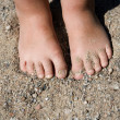 Feet in sand — Stock Photo