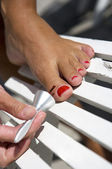 Painting toe nails — Stock Photo