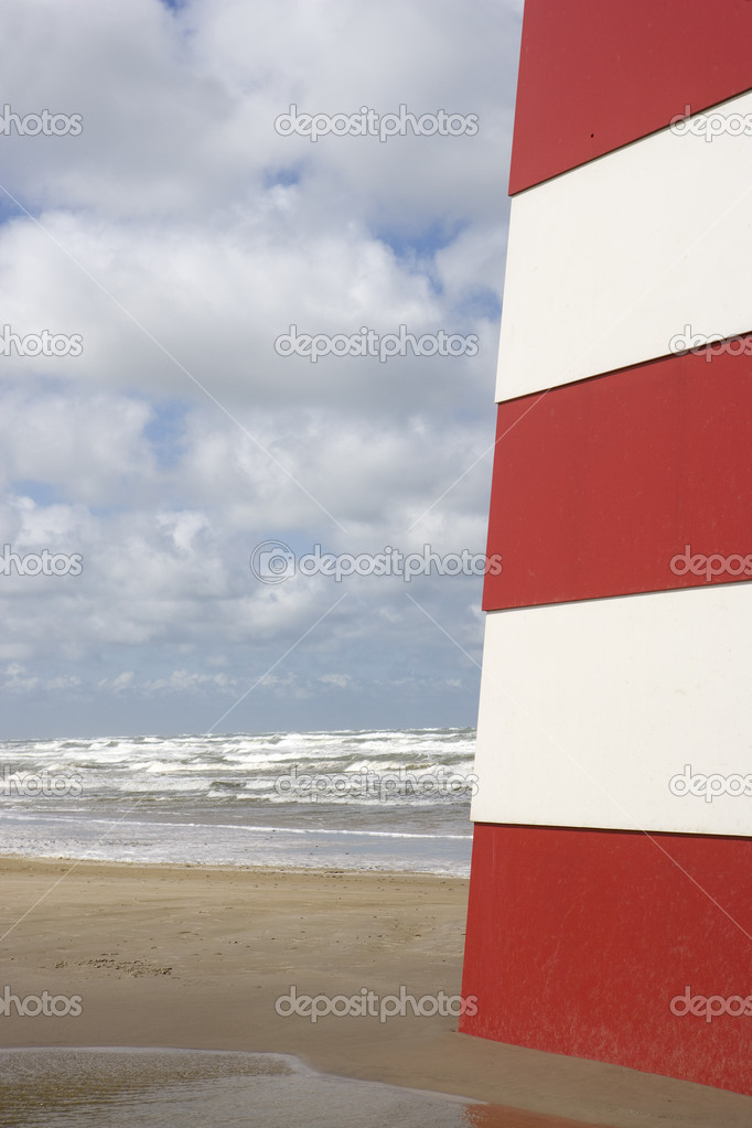 Red and White Landmark on the beach — Stock Photo #9457665