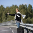 Hitchhiking woman — Stock Photo