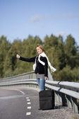 Hitchhiking woman — Stock Photo