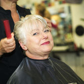 Woman and hairdresser — Stock Photo