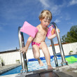 Girl in swimming pool - Stock Photo