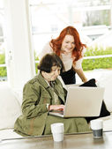Women by the computer — Stock Photo