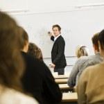 Teacher in classroom — Stock Photo