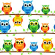 Seamless owls on tree branch — Stock Vector