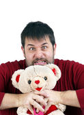 Man strangling teddy bear — Stock Photo