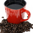 Red coffee cup and beans — Stock Photo