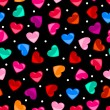 Seamless colorful heart shape pattern over black — Stock Vector