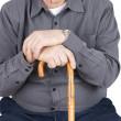 Torso of senior with cane — Stock Photo