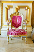 Vintage pink silk and gold frame chair — Stock Photo