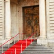 Red carpet over stairs — Stock Photo