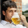 Young guy drinking beer — Stock Photo #9446520