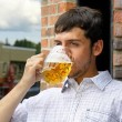 Young mbinging on beer — Stock Photo #9448994