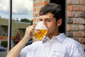 Young man binging on beer — Stock Photo