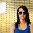 Tough girl and brick wall — Stockfoto