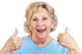 Happy senior woman thumps up — Stock Photo