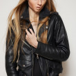 Stock Photo: Beautiful portrait of rock woman model in leather jacket with dark evening make-up. Perfect street fashion. Personal accessories, clothes