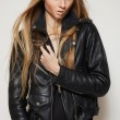 Beautiful portrait of rock woman model in leather jacket with dark evening make-up. Perfect street fashion. Personal accessories, clothes — Stock Photo #9224531