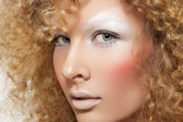 Lovely model with shiny volume curly hair, winter white eyeshadows make-up, pale lips and pink cheeks. Christmas look with frizzy hairstyle — Stock Photo