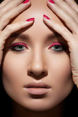 Beautiful close-up portrait of fashion woman model with glamour magenta makeup, pale lips, bright pink nail polish. Fresh style, visage and manicure — Stock Photo