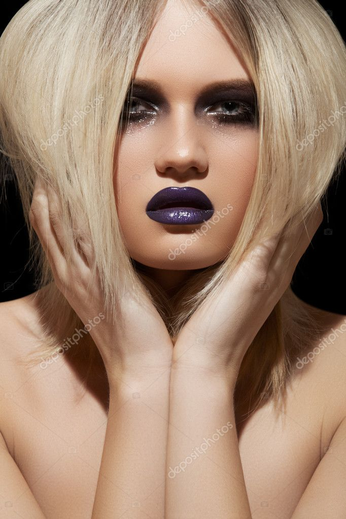 Punk rock style or halloween make-up. Fashion woman model face with bright glamour makeup. Perfect skin, black gloss eyeshadows on eyes and dark violet glossy lips visage.   Stock Photo #9224367