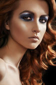 Beautiful face of young woman with brunette long ringlets hairs and dark fashion make-up — Stock Photo