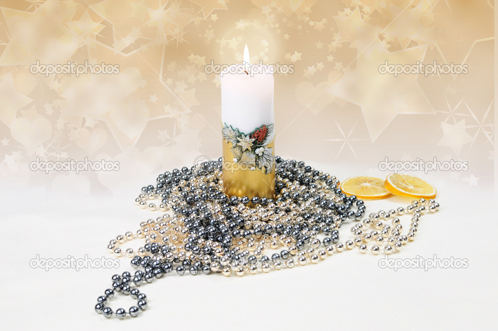 Gold and white festive candle burning — Foto Stock #10142684