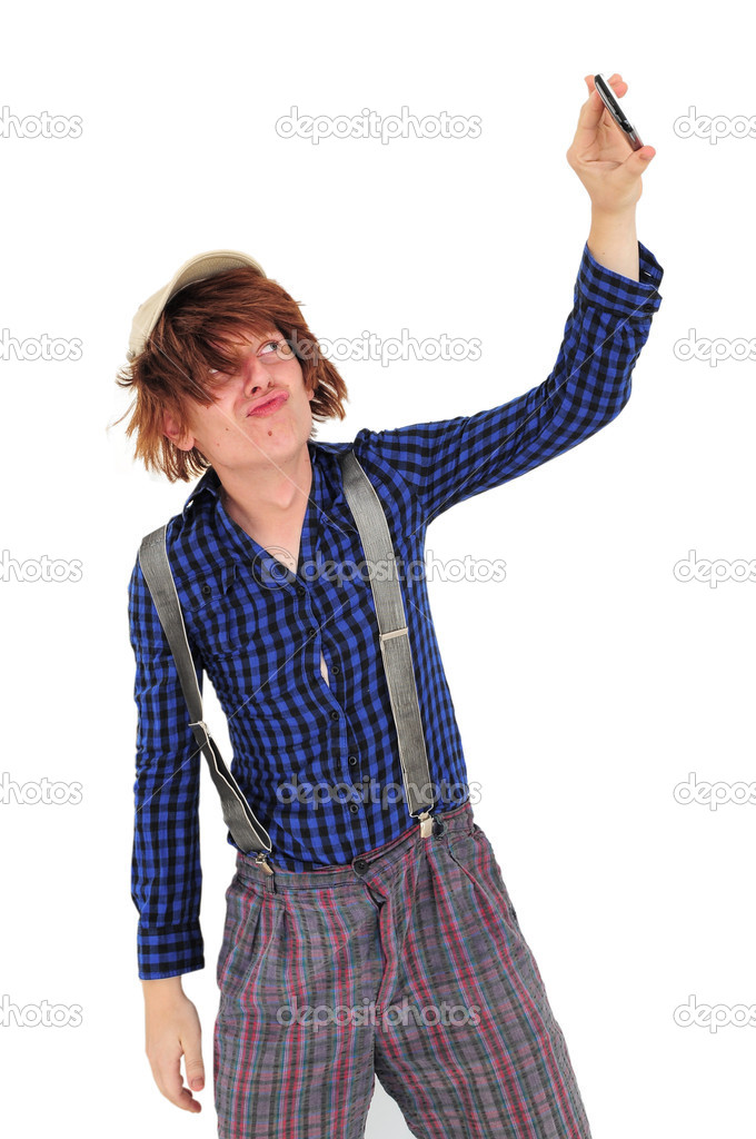 Guy in funny clothes taking self portrait with his phone — Stockfoto #10145255