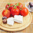 Fresh tomatoes, olives and whote cheese — Stock fotografie