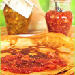 Pancakes and fruit jam - Stock Photo