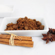 Brown sugar, cinnamon sticks and anise — Stock Photo