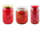 Jars with different preserved vegetables — Stock Photo