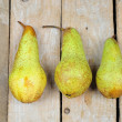 Three pears on wooden background — Stockfoto