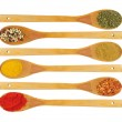 Various spices in wooden spoons isolated — Stock Photo #9166137