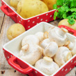 Raw mushrooms and potatoes in red trays — 图库照片