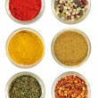 Various spices in round glass bowls - Foto Stock