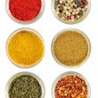Various spices in round glass bowls - Stockfoto