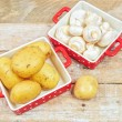 Raw mushrooms and potatoes in red trays — Foto Stock