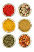 Various spices in round glass bowls — Stock Photo