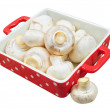 Fresh mushrooms in red tray, isolated — Stock Photo